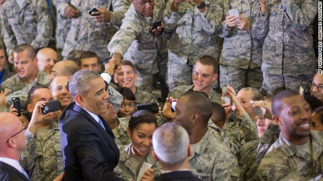 140917180059-obama-troops-smiling-story-top
